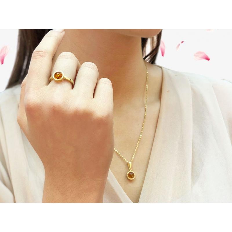 Pierścionek złoty z naturalnym bursztynem i cyrkoniami Swarovskiego
