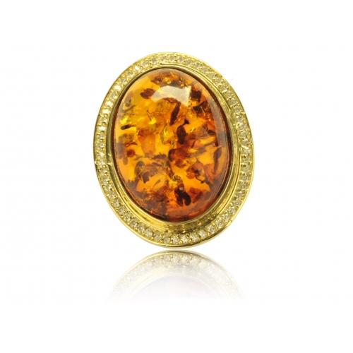 Pierścień złoty z dużym naturalnym bursztynem i małymi cyrkoniami Swarovskiego